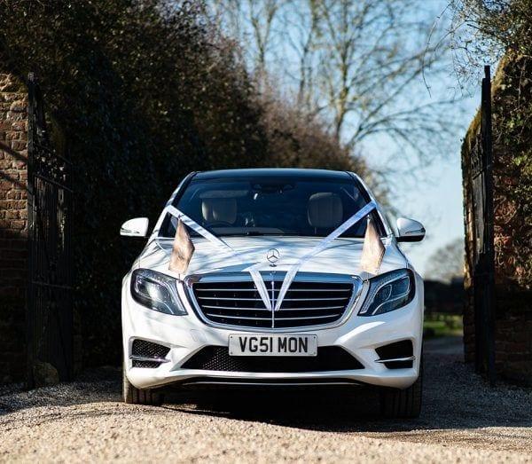 Chauffeur driven White Mercedes wedding cars London.