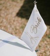 Wedding car Suffolk, beautiful bespoke wedding flags for Mercedes white wedding car hire.