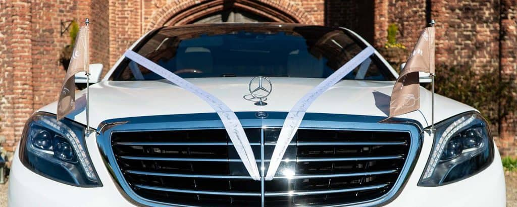 wedding car hire with ribbons and flags