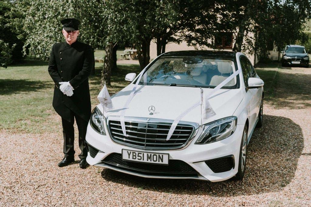 Chauffeur and wedding car