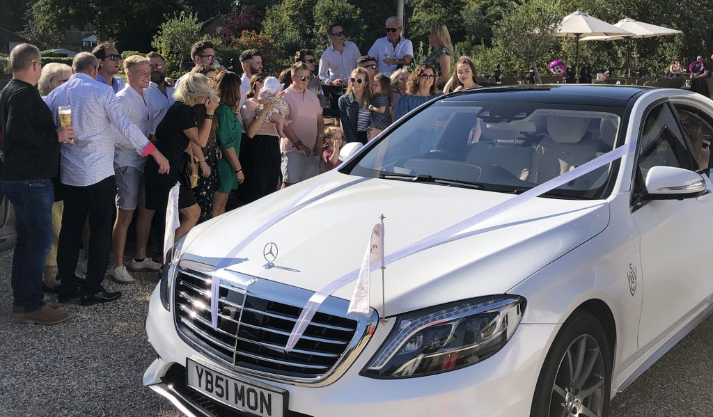 wedding car with guests