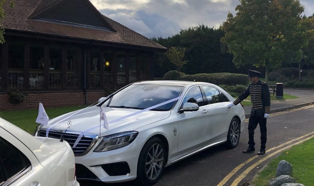 Chauffeur driven wedding car